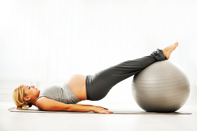 Pregnant women exercising on fit ball